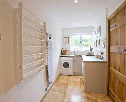 Wash/dry room with heated cupboard for muddy boots!