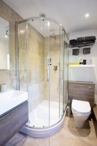 upstairs bedroom with beams ensuite shower